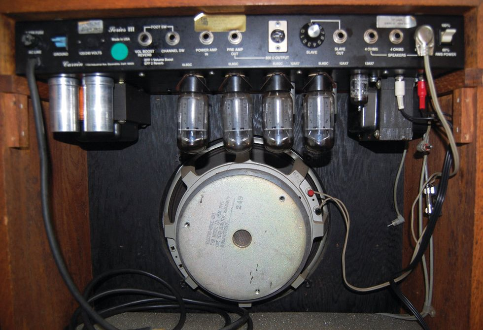 A rear view displays the EV 12L speaker and array of 6L6 power tubes and  three 12AX7s. The reverb is solid-state, driven by a pair of discreet  transistors.