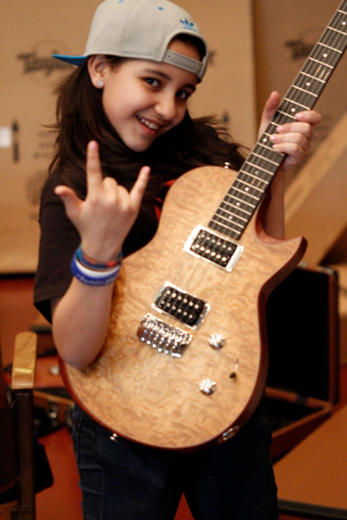Taylor Guitars Pledges 300 Guitars to Little Kids Rock