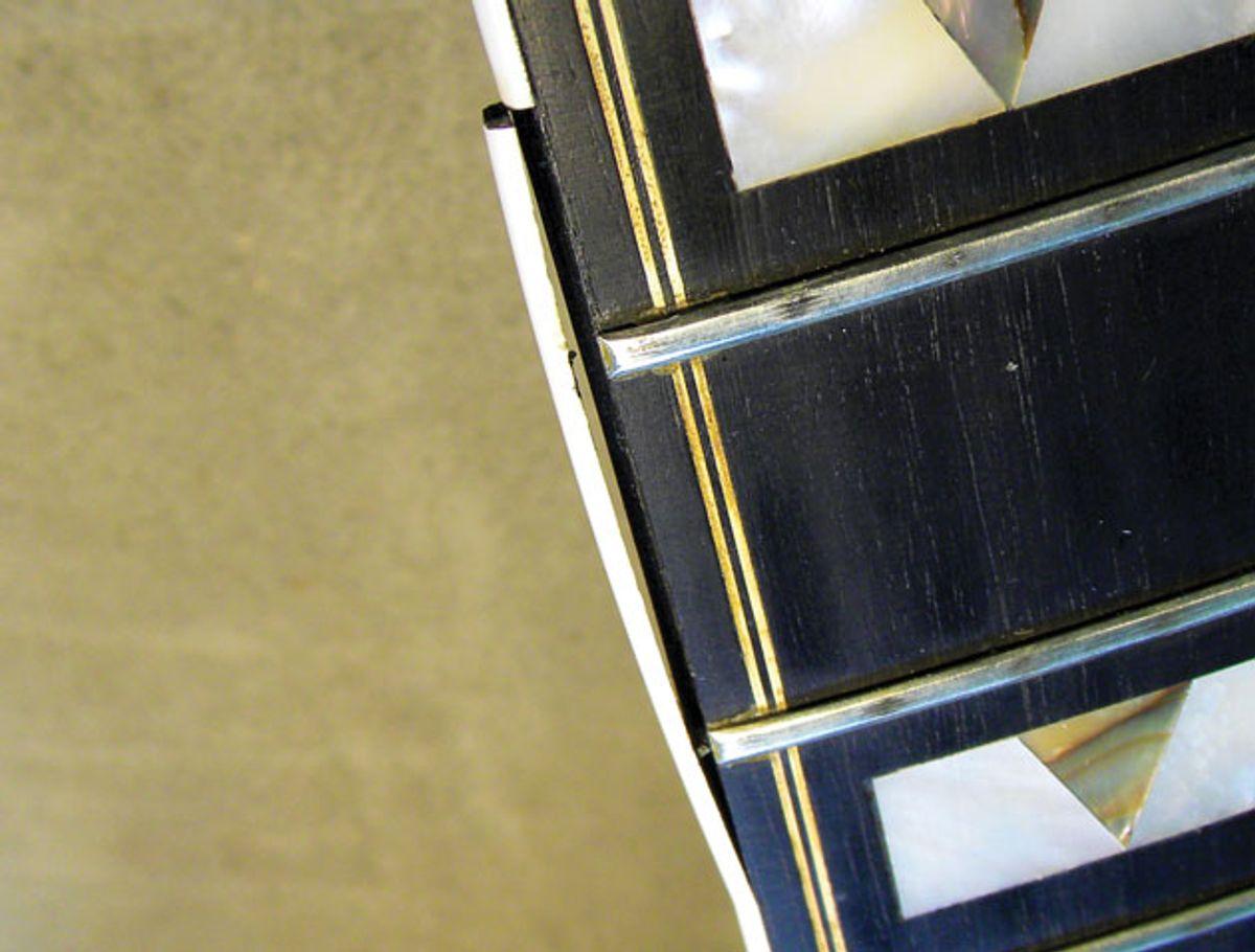 Guitar Shop 101: How to Repair Delaminated Neck Binding