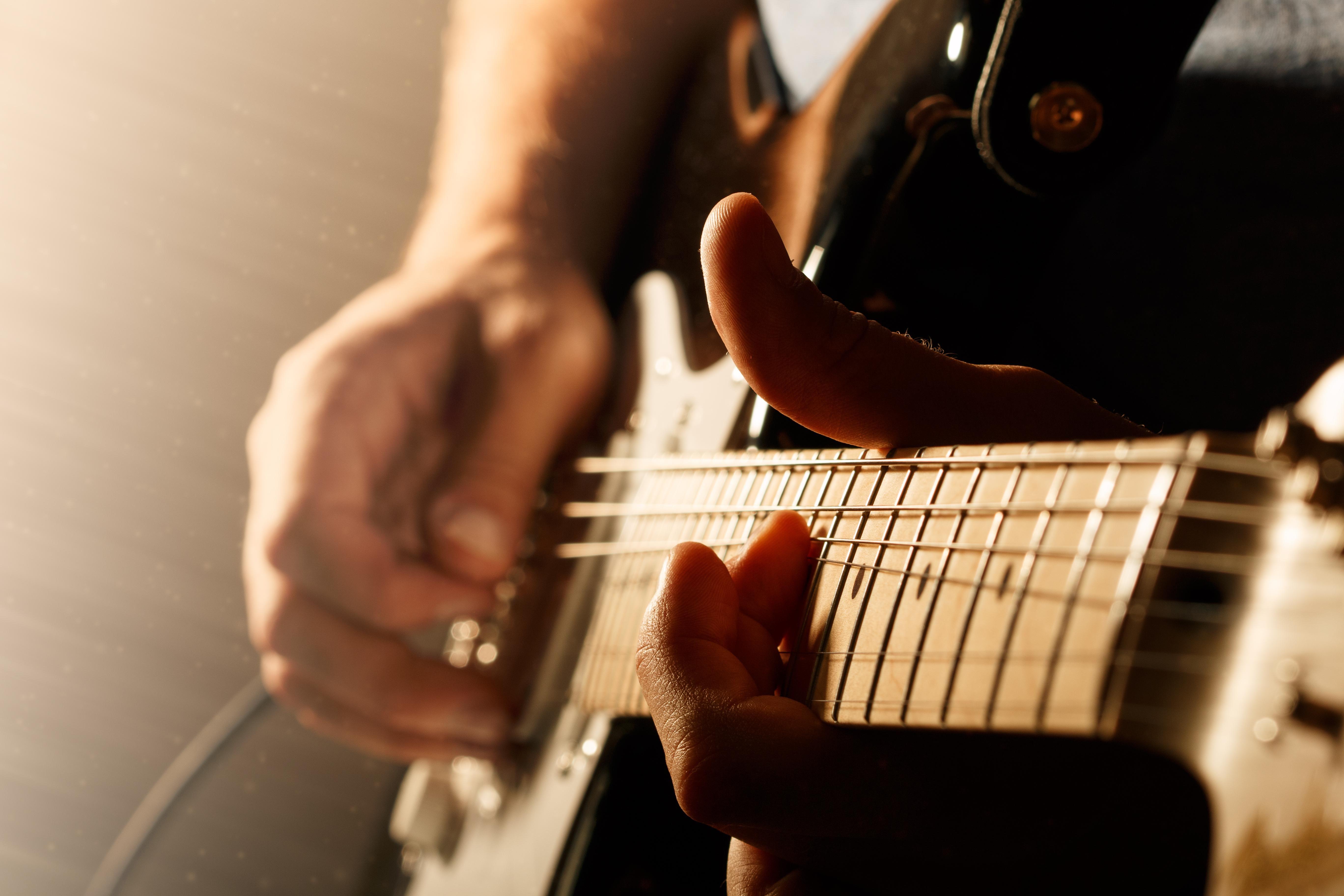 Guitar string bending