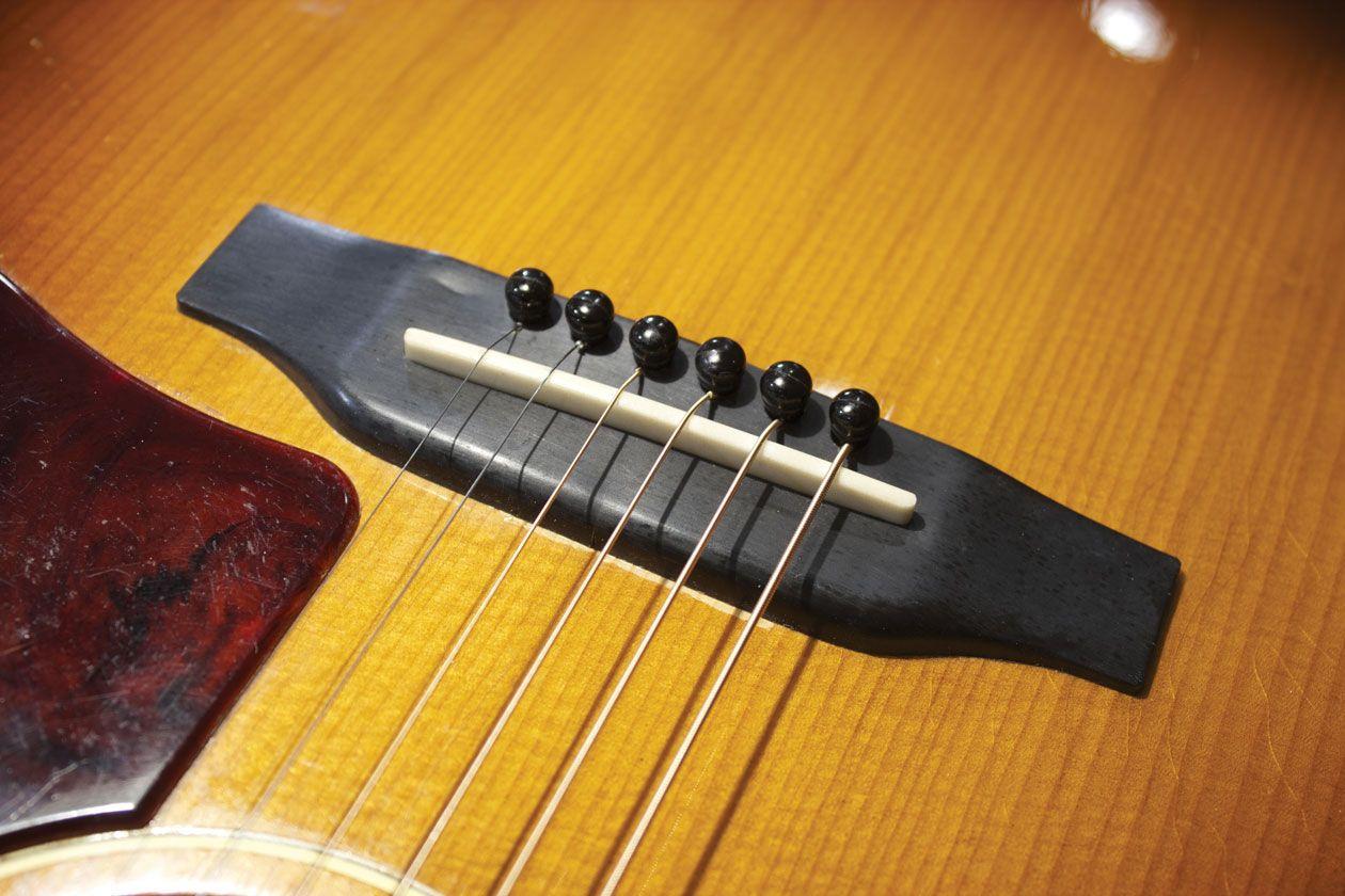 Why Plastic Bridges and Acoustic Guitars Don't Mix